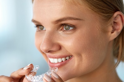 Closeup Of Beautiful Happy Smiling Woman With White Smile, Straight Teeth Holding Whitening Tray