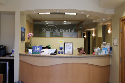 Skyline Dental Office Reception Area with woman on phone