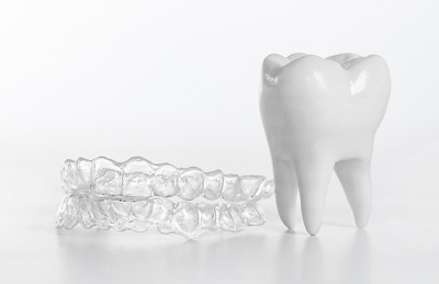 invisalign clear braces and tooth model