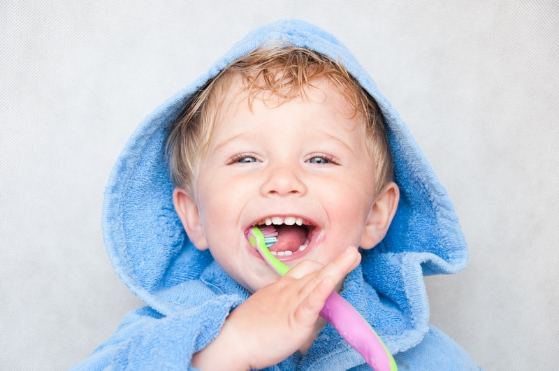 Smiling child with toothbrush
