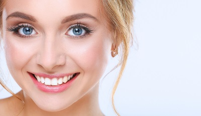 woman smiling with healthy white teeth