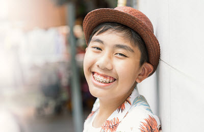 young asian man with braces