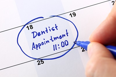 Calendar with dental appointment on it