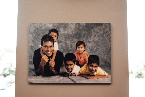 office photo of Dr. Khara and his children