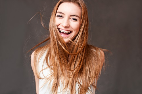 laughing girl wearing braces, cheerful portrait