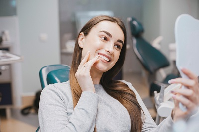 young girl smiling at the dental chair