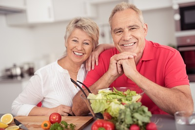 Smiling adults sitting in kitchen