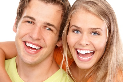 Happy smiling young couple over white background