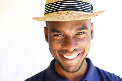 Close up portrait of cheerful young man