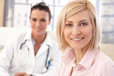 Close up of happy blonde casual caucasian female patient at doctor's medical office