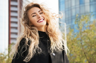 woman with beautiful smile in city background