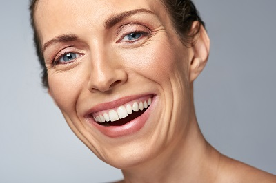 close up of smiling woman with healhy gums