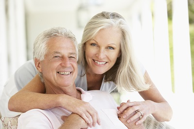 Portrait Of Senior Couple smiling at home