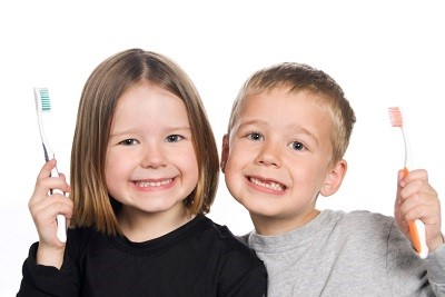 Picture of children with bright, healthy smiles after using aesthetic dental services from Pediatric Dentistry in Syosset.