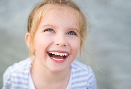 child with beautiful healthy smile after visiting pediatric dentist in odessa