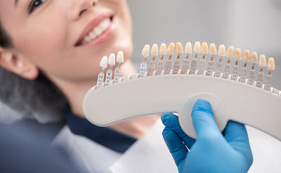 woman getting veneer treatment in dental office