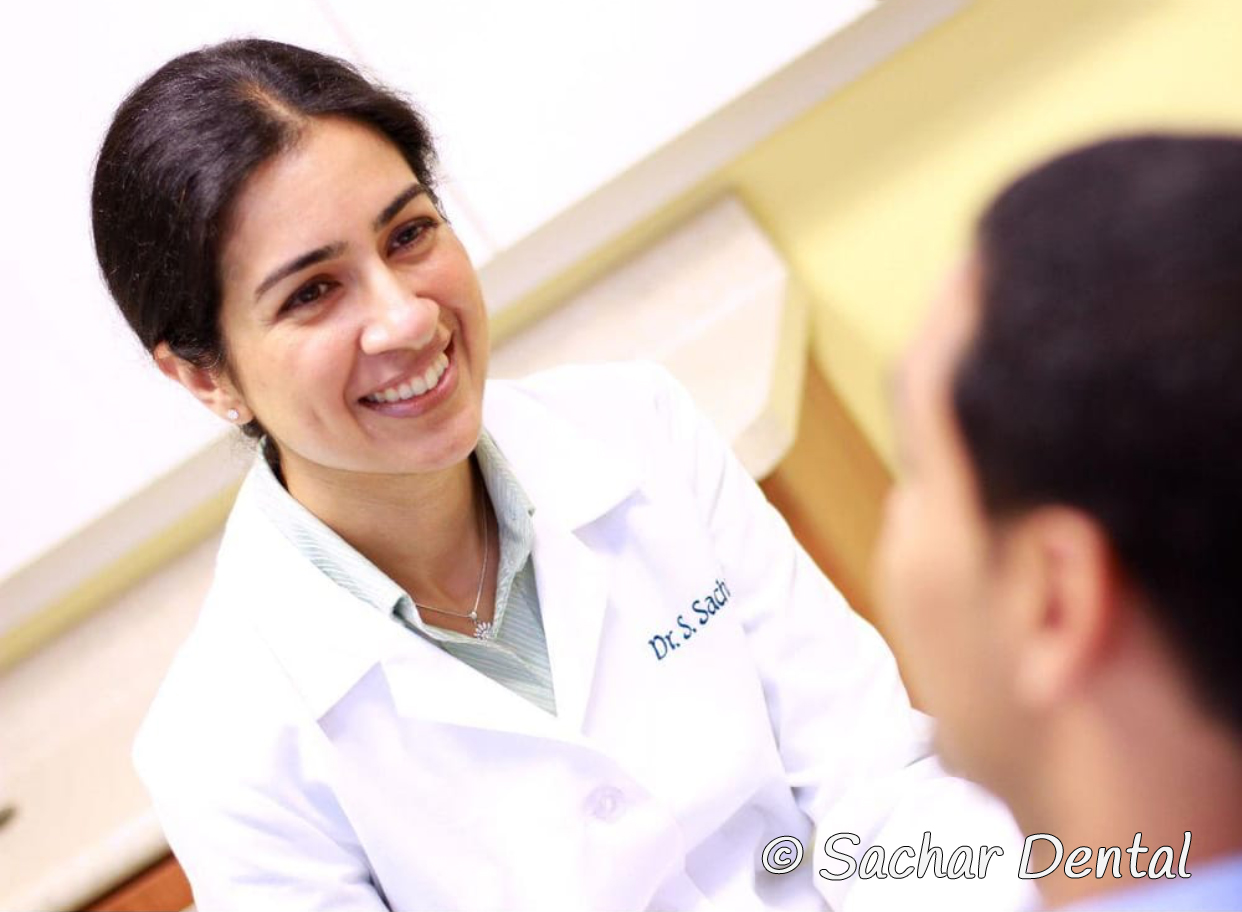 Top Dentist NYC -  Dr Sandip Sachar with a patient