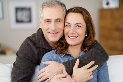 smiling mature couple at home