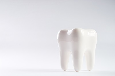 healthy tooth over white background