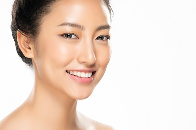 Beautiful Young Asian Woman with Clean Fresh Skin and healthy teeth