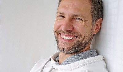 smiling mature man over white background