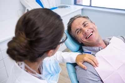patient discussing dental implant procedure at dental office