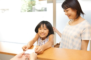 asian woman and child at dental office