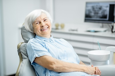 Portrait of a beautiful senior woman with healthy smile sitting at the dental office