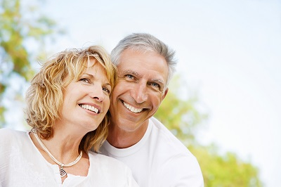 mature couple smiling at the park