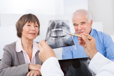 mature couple getting dental consultation in dental clinic