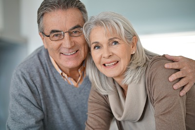 Portrait of senior couple looking at camera at home