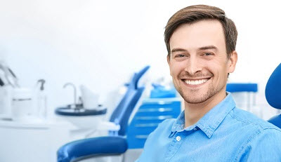 smiling male patient in dental office