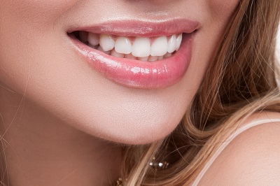 close up of woman smiling with healthy teeth