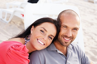 Happy smiling middle-aged couple on a beach