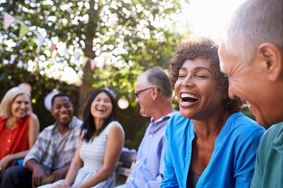 senior friends laughing at the park