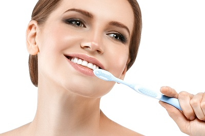 Woman with tooth brush and healthy teeth