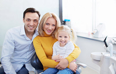 Image of happy family in dentist office