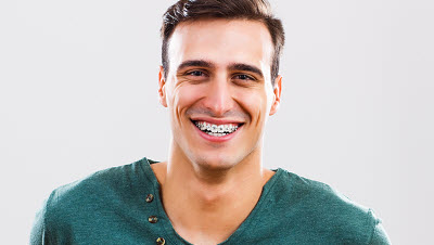 man with braces smiling