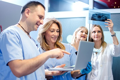 Group of cheerful healthcare workers working together at doctor's office