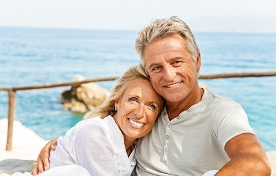 mature couple on private boat smiling