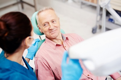 senior man getting a consultation for dental implants
