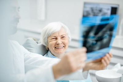 senior woman having a dental implant consultation