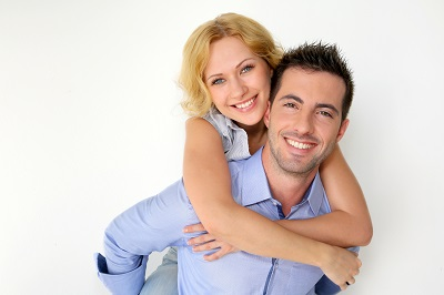 happy couple over white background