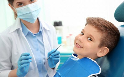 little boy getting dental inspection