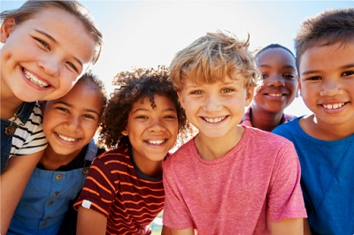 Image of smiling group of kids outside