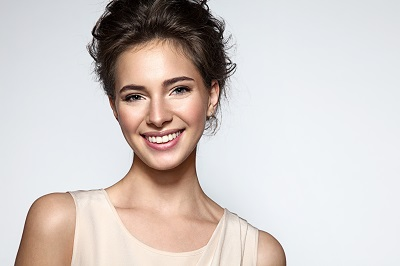 beautiful smiling woman over light background