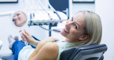 woman smiling in dental office