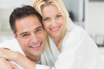 close up of couple with healthy smiles