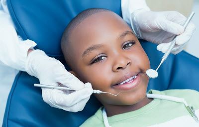 african american boy getting a dental check up