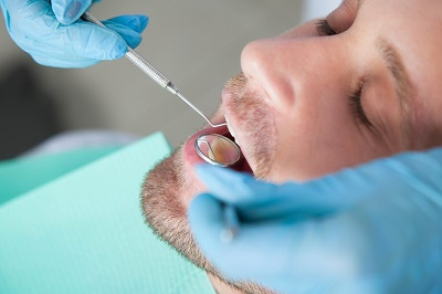 male patient getting a dental exam